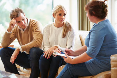 counselor advising young couple
