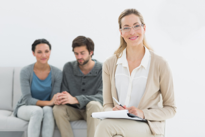 female counselor with young couple